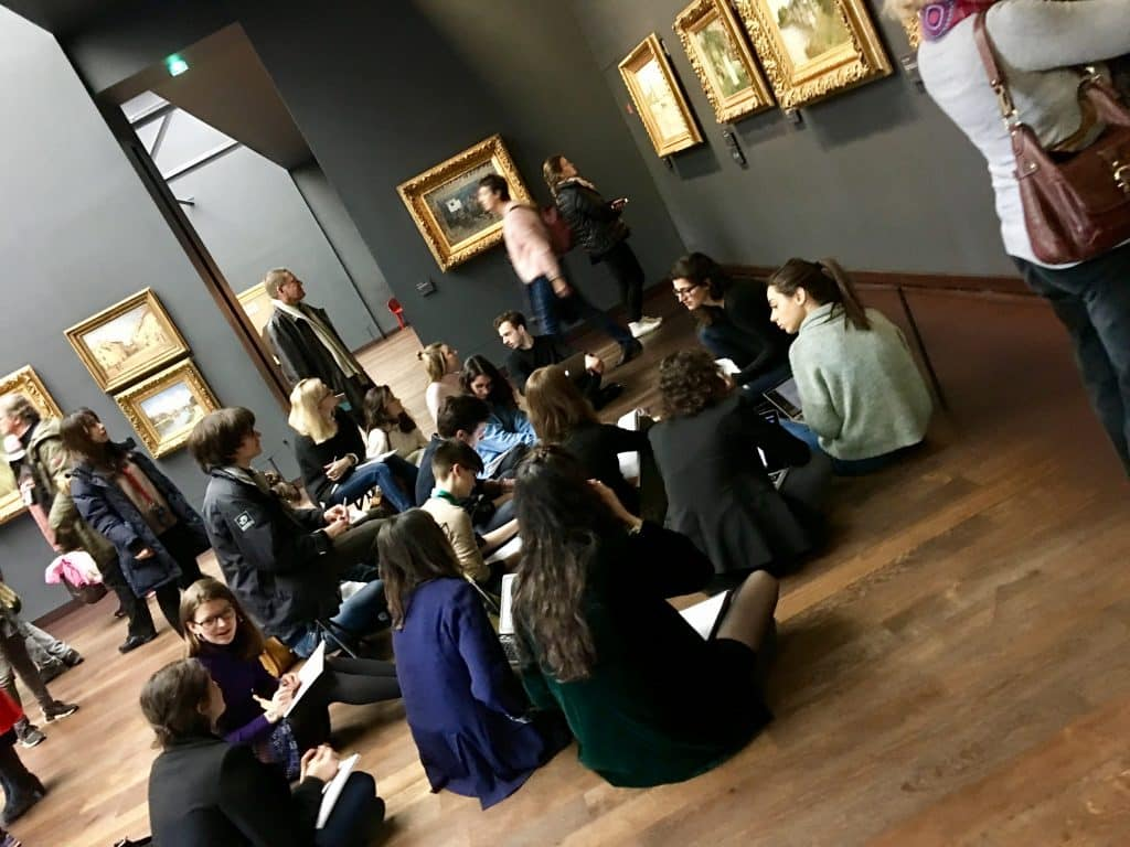 Art students on floor sketching art at the Museum d'Orsay