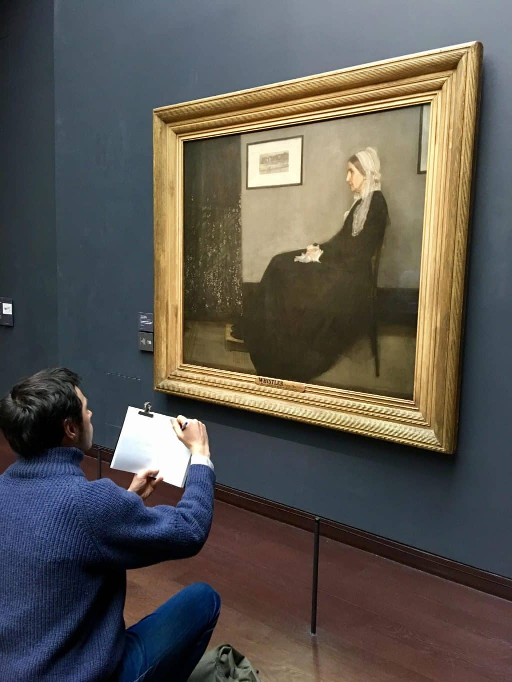 Whistler's Mother with artist on floor sketching
