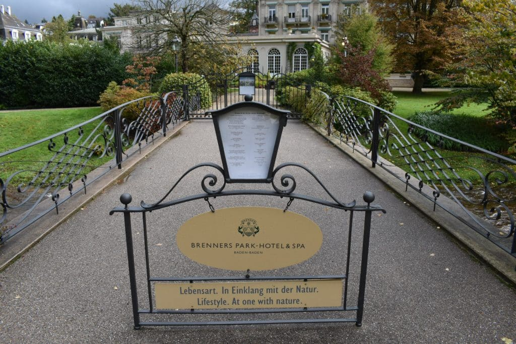 The back entrance sign with coded gate to the Brenner's Park-Hotel & Spa