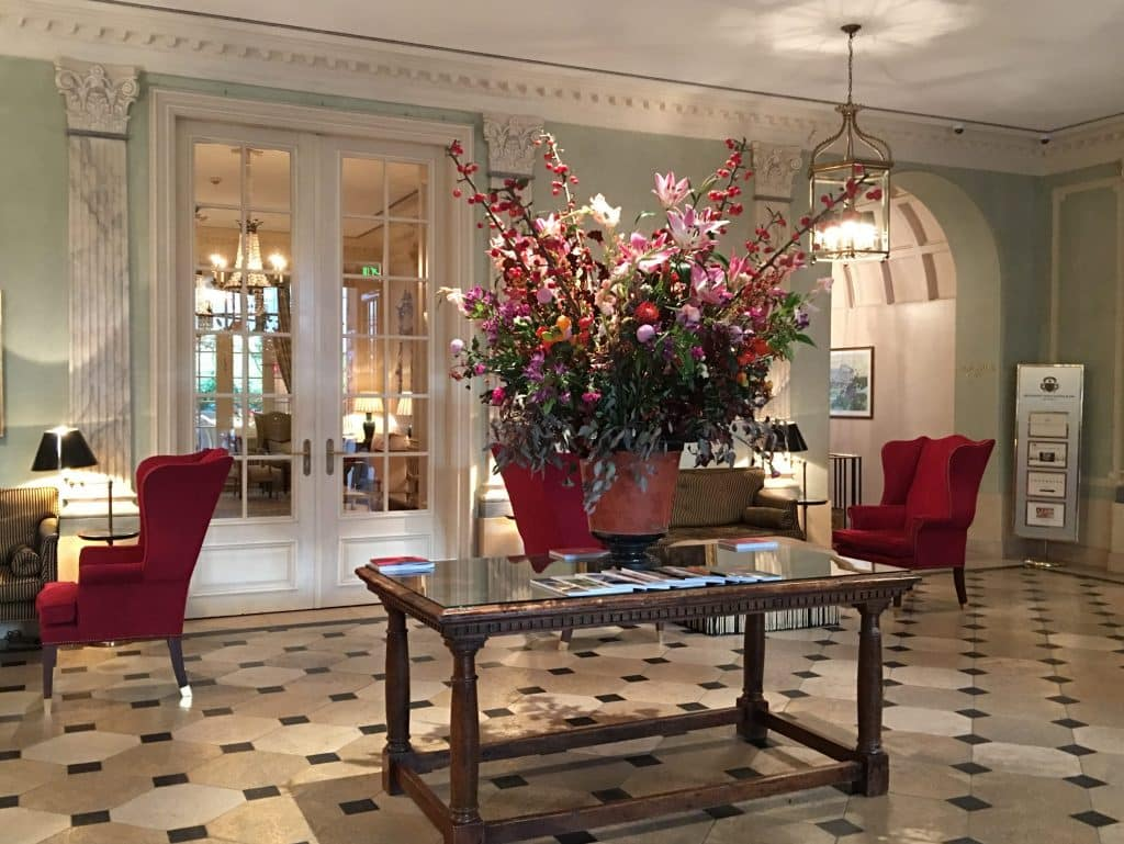 Brenners Park-Hotel & Spa lobby with flowers on table and checkered floor