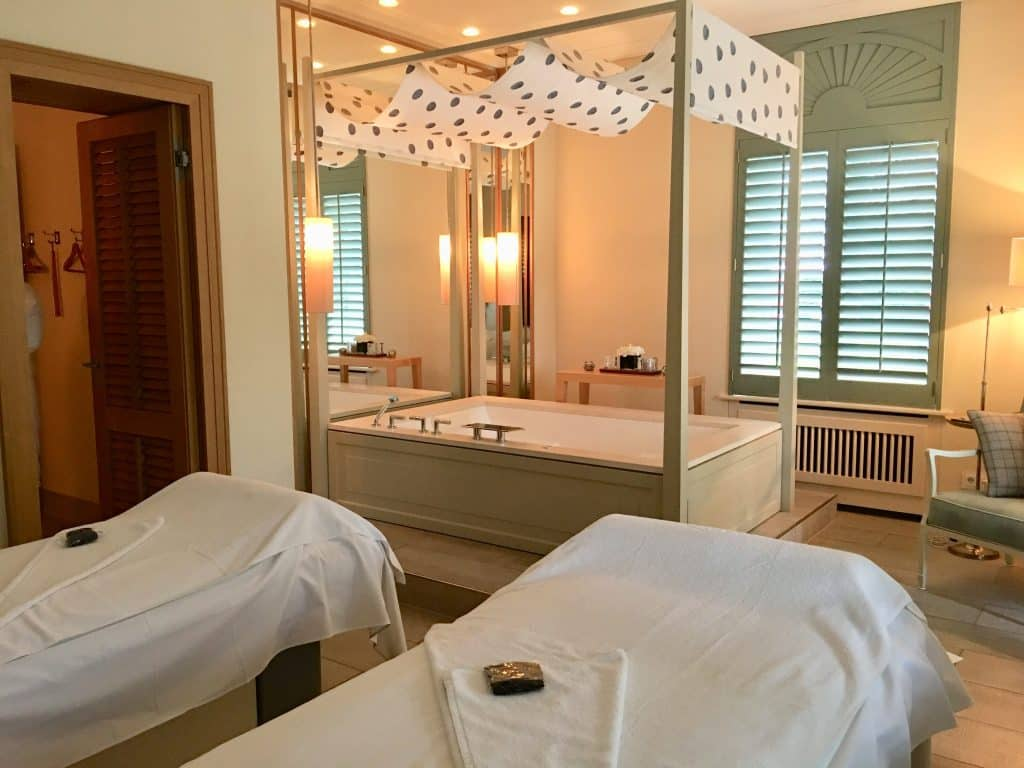 2 beds for massage and tub in spa at Brenners Park-Hotel & Spa