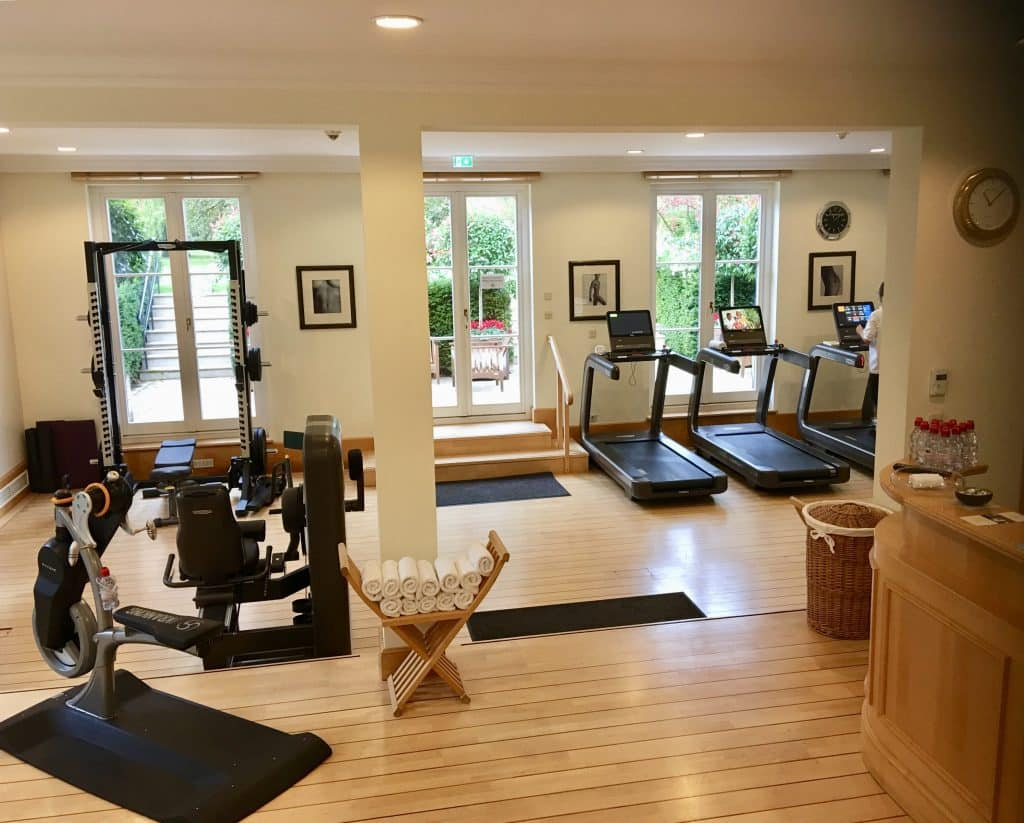 Workout area at Brenners Park-Hotel & Spa; treadmills, bikes, weights