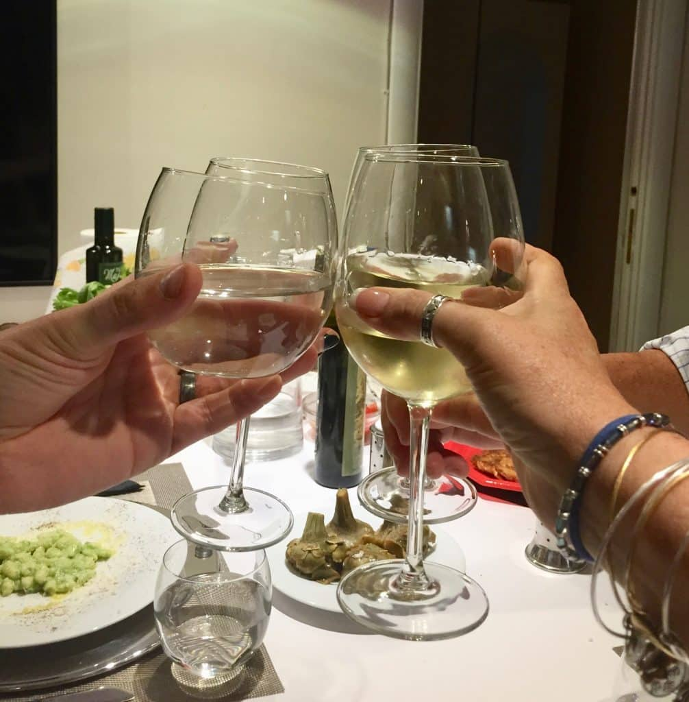 4 glasses of wine cheers to successful cooking school in Rome