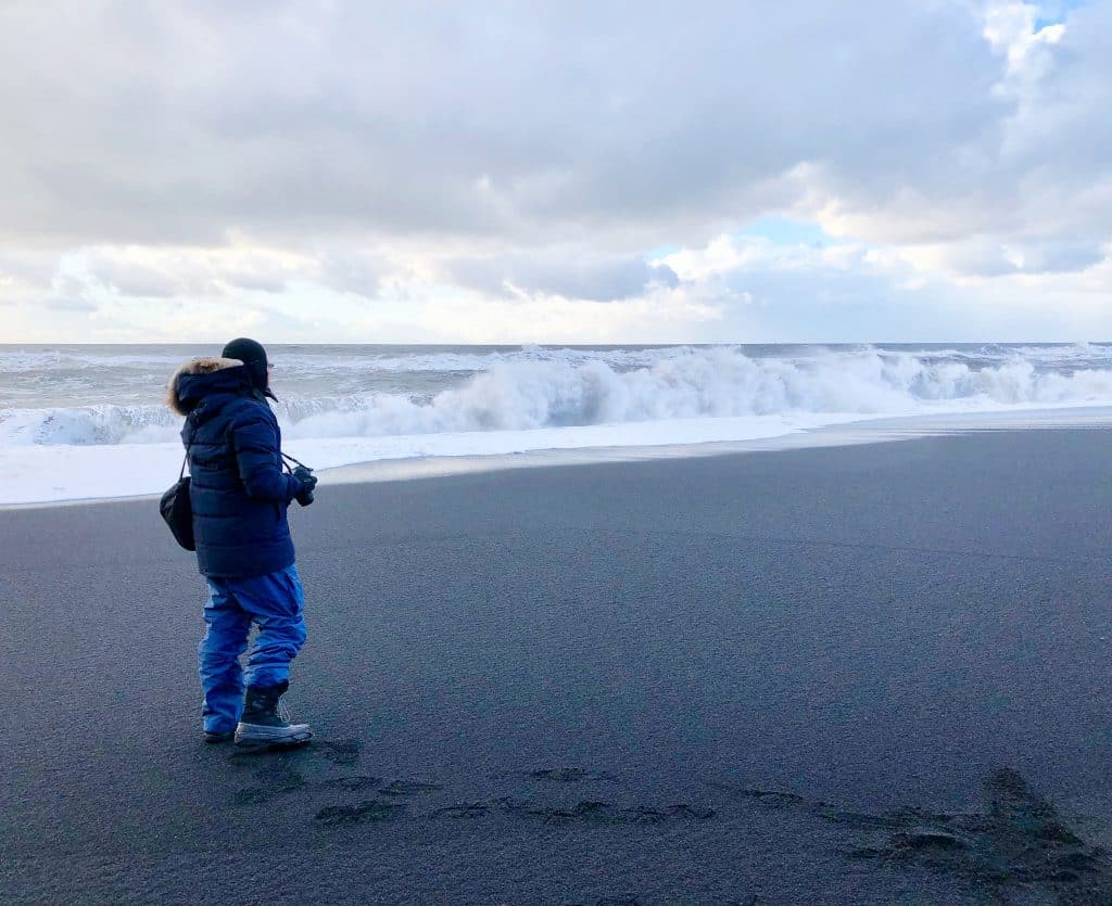 Photography in the winter on black sand beach Iceland