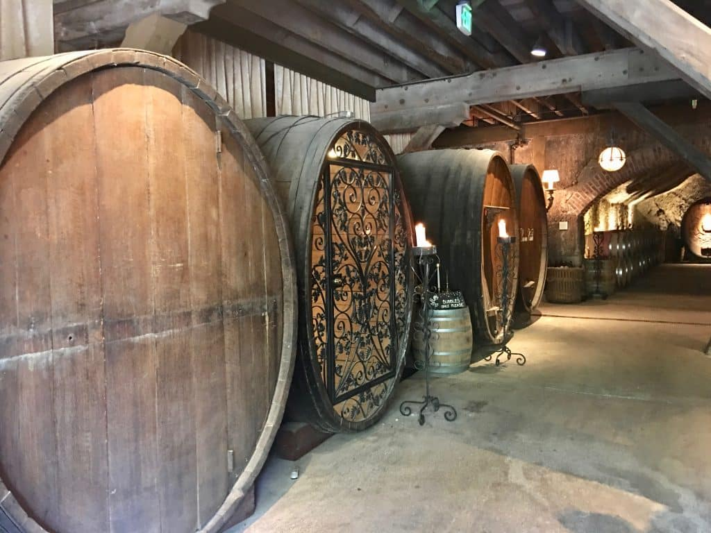 Wine barrels in winery to store the wine