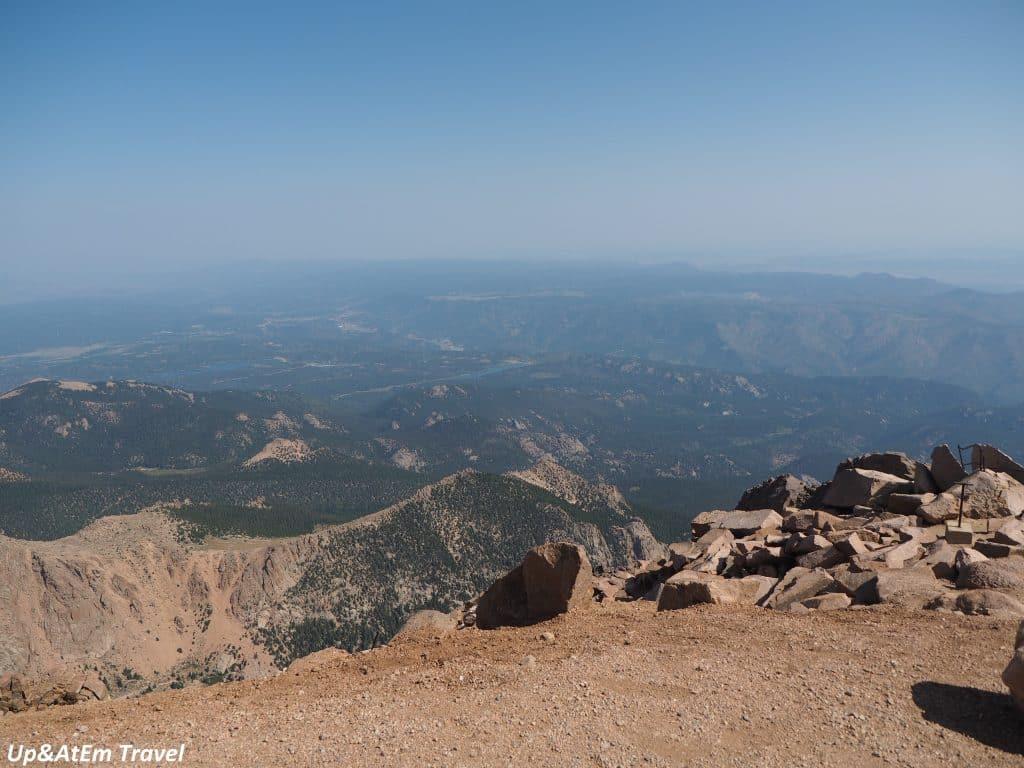 Adventure Travel: Adventure Seeker Biking down hill in Colorado Mountains