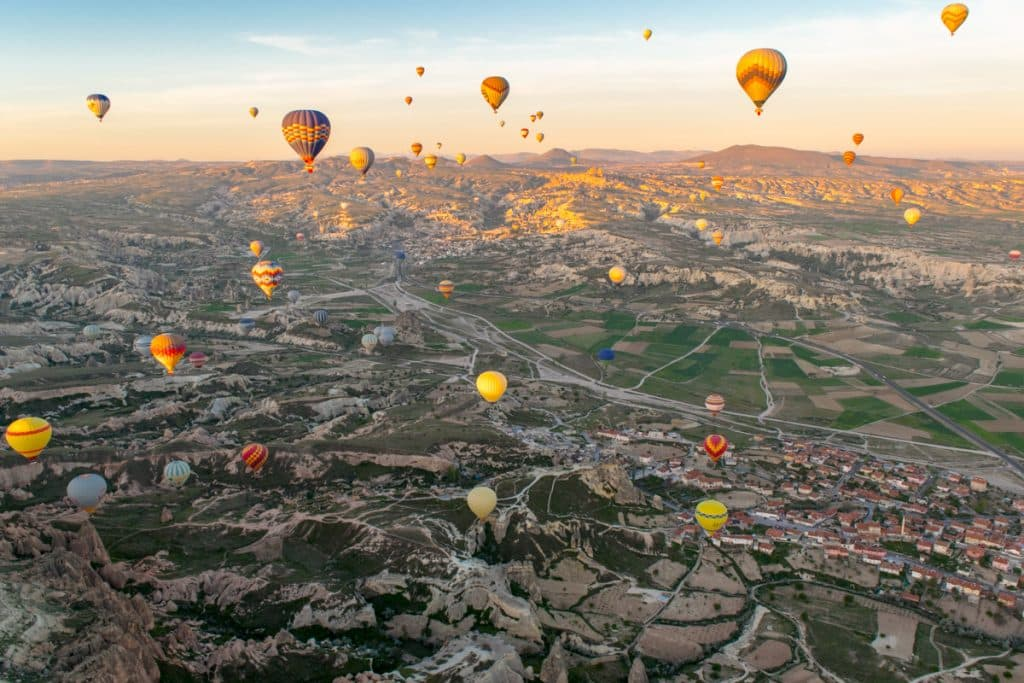 Adventure Travel: Adventure Seeker in Hot Air Balloon over Cappadocia, Turkey