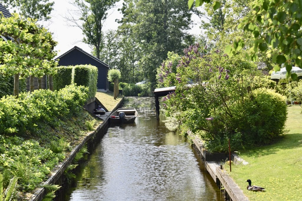 A private area of canal with a boat in Giethoorn Netherlands