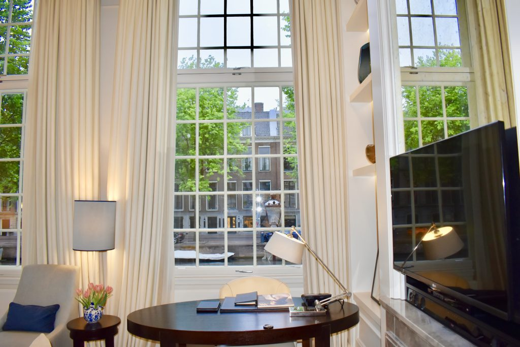 Tall windows to view the canal at the Waldorf Astoria Amsterdam