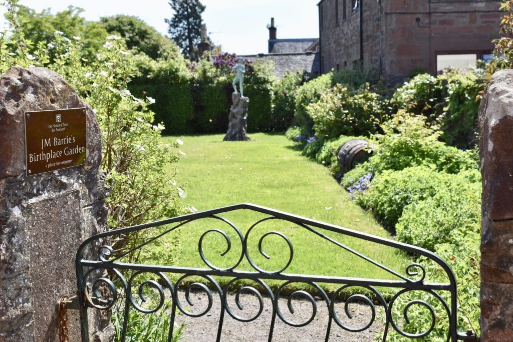 Looking into the garden with gate of Peter Pan Novelist, J.M. Barrie: Childhood home, Kirriemuir Scotland. Garden area