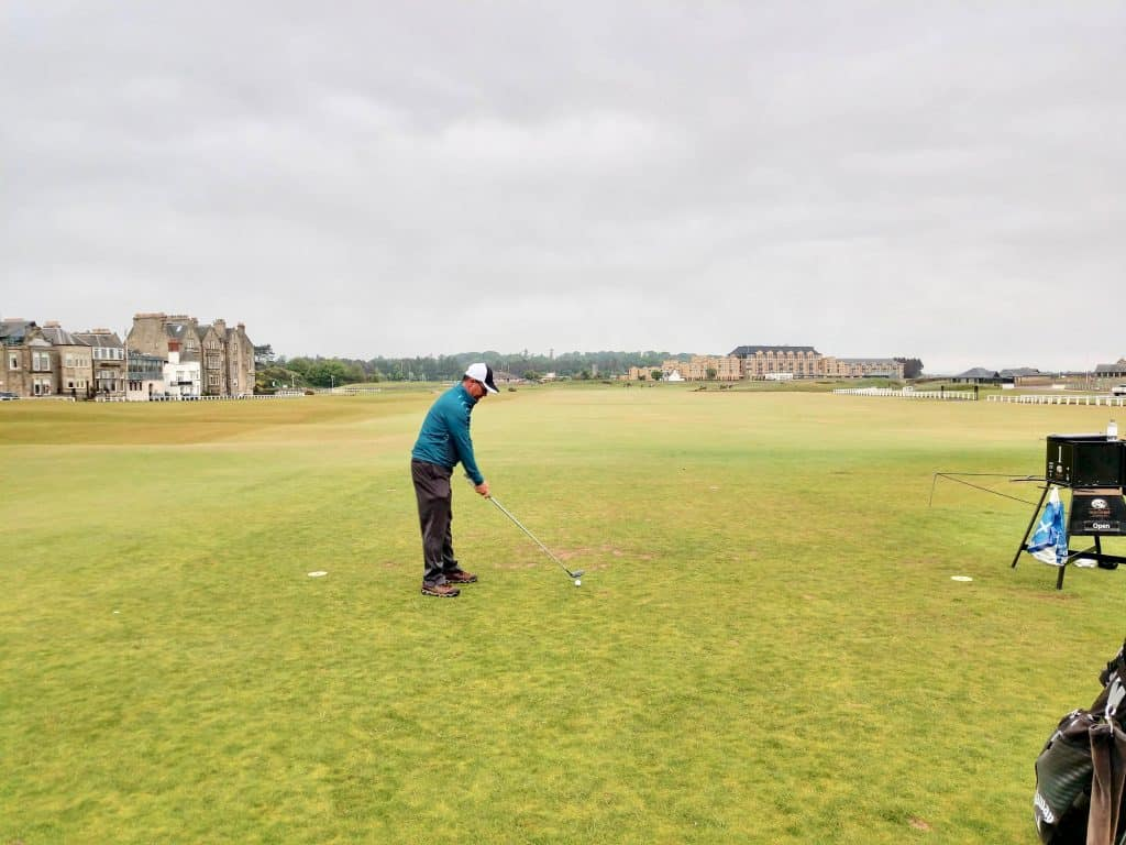 ready to take a swing while golfing on old course St. Andrews Scotland