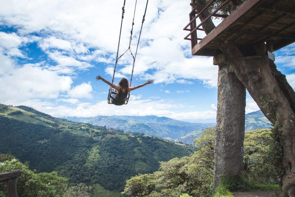 girl swinging on swing in Ecuador